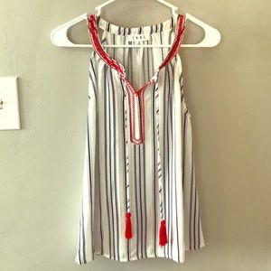 Light blue and white striped shirt w red tassels.